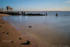 Marée descendante et soleil couchant Les Boucholeurs - Carrelets