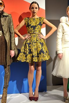 Alice + Olivia Fall 2012. Been obsessing over this 50s style black dress with yellow flowers.