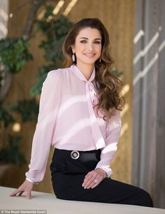 Queen Rania of Jordan has released a new official portrait to mark her 46th birthday, showing her in an elegant ensemble of a pink pussy bow blouse and black pencil skirt