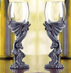 """Set of 2 Gothic Medieval Dragon Goblet Fantasy Glasses . $39.99. Polyresin and glass. Hand wash. Each is 3"""" diameter x 8"""" high.  Set of 2. Finally -- a drinking vessel worthy of the """"Lord of the Castle""""! An imposing roaring dragon forms a majestic base for a clear glass globe; this medieval-style goblet looks as impressive in your hand as it does at the head of the banquet table! Polyresin and glass. Hand wash. Each is 3"""" diameter x 8"""" high.  Set of 2"""