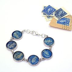postage stamps bracelet..love this blue!