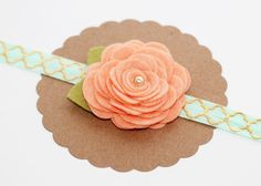 This pretty felt flower headband is made of high quality wool blend felt fabric. The color of the flower is georgia peach and centered with a