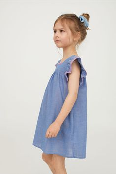 A-line dress in airy, woven cotton fabric with a yoke at top. Short, embroidered butterfly sleeves, buttons at back, and concealed side-seam pockets. Cotton Dresses, Blue Dresses, Summer Dresses, Chambray, Cotton Fabric, Cold Shoulder Dress, Sleeves, Kids, Fashion