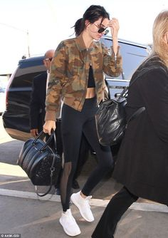 Kendall Jenner flashes a hint of her toned tummy in cropped tee at LAX - Celebrity Style