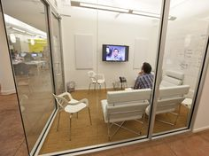 Small meeting rooms around the office are equipped with screens for videoconferencing. - BuzzFeed | Business Insider