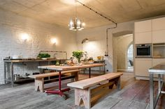 Surrounded by a forest in the suburbs of Berlin, this rustic apartment in a Mediterranean-style building is the result of an extensive restoration project.