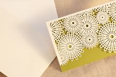 Laser Cut Parasol Notes: Presented with the most enticing texture, these notes feature graphic lace intricately laser cut atop brilliant kiwi. Sure to please the correspondent who appreciates a modern luxury.