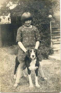 Vintage photo of a girl and her dog.