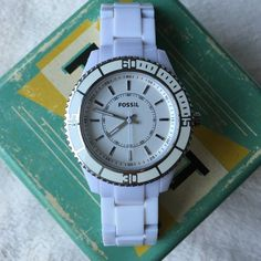 Fossil White Watch EUC. Only minor scratches on the clasp. I had some links removed to fit my wrist. Working battery. Fossil Accessories Watches