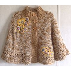 Lulumari Floral Swing Cardigan Excellent condition. Very little wash wear. A couple of lumps of pulled yarn. Super cute Lulumari sweater from Anthropologie. Swing style cardigan with only top buttons. Light color wood-looking buttons. Embroidered floral appliques on the front. Tan and white blended knit. Open design at the end of the body and sleeves. Wide 3/4 length bell/kimono sleeves. Ribbed high collar. Size small. +All offers welcome Anthropologie Sweaters Cardigans