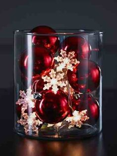 Get the Christmas look with this unique lantern effect by filling an empty vase with traditional fairy lights and shiny baubles. Lets modernise a classic look and fill those empty spaces, perfect for side tables and window sills.