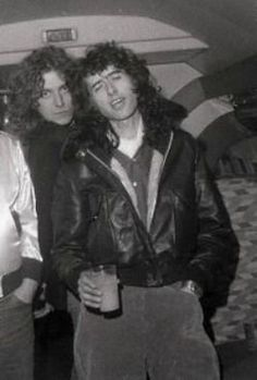 "Jimmy Page & Robert Plant aboard Led Zeppelin's private jet, ""The Starship"":"