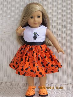 The Dolls like to dress up for Halloween too! This Halloween Doll Dress is for all 18 inch dolls, like the American Girl, and Our Generation. It has an embroideried Black Cat on the fully lined bodice. The full gathered skirt is orange cotton with tumbling matching Black Cats. The waist is accented with a black grosgrain ribbon. The bodice and skirt are completely open and closes with velcro. The open back and sleeveless style makes for very easy dressing of the doll. I made this dress in…