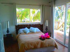 Habitación Cayla; Lujosa e increíblemente agradable; hermosa vista al mar y al más bello de los atardeceres; baño compartido y exclusivas duchas al aire libre con vista al mar en Hotel Boutique Playa Tranquilo