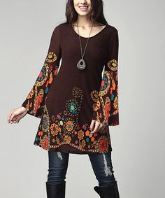 a moody floral print and ruffled trim define the boho vibe of this