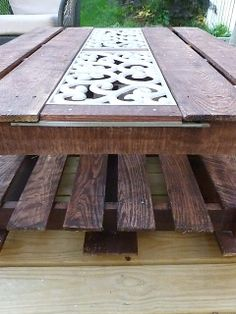 Pallet Coffee Table; instructions with metal scroll work insert.