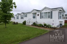 $58,900 2 Lobelia Street, Moncton, NB, Turn key mini home on landscaped corner lot in Pine Tree Village. Bright oak kitchen with dining area. Lovely hardwood floors in the living room and hallway. Large master bedroom on the far end of this mini home provides a quiet area to sneak away for a nap. #moncton #realestate #NewBrunswick #Martellrealty #buyingahome