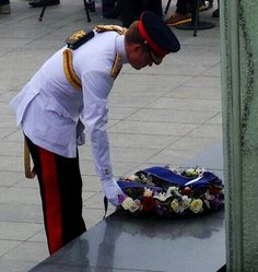 Prince Harry laying a wreath to the monument of Freedom
