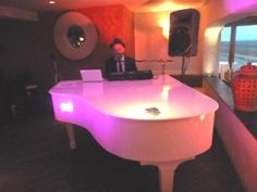 My own 6ft portable white baby grand piano here for a wedding at Sheldrakes Wirral, UK in 2011