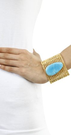 Filigree open cuff with turquoise stone by ROHITA AND DEEPA. Shop at https://www.perniaspopupshop.com/whats-new/rohita-and-deepa-15