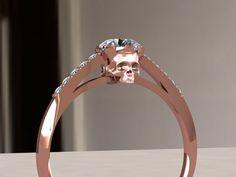 Rose gold skull engagement ring. $2,500.00, via Etsy.