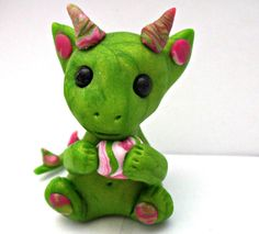 Meet  baby Harlequin. She is a tiny handmade collectable dragon a one of a kind model without the use of moulds. She is new from my Dinky dragon range. At 1 and 1/2 inches tall she is much smaller than my usual dragons but still as cute for pocket money prices.  Uk price £5.00 . Converted to GB p...