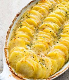 INGREDIENTS    4cups thinly sliced potatoes  3tablespoons butter  3tablespoons flour  1 1⁄2cups milk  1teaspoon salt  1dash cayenne pepper  1cup grated sharp cheddar cheese  1⁄2cup grated cheese, to sprinkle on top      DIRECTIONS  In a small sauce pan, melt butter and blend in flour.  Let sit for a minute.  Add
