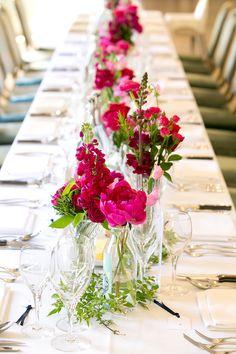 Bright pink table flowers: peonies, roses, stocks, sweet peas, snapdragons & herbs