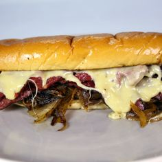 Michael Symon ~ Pastrami Sandwich Recipe ~ Michael shows you the right way to nosh with his mile high sandwich!