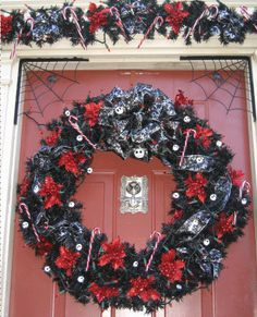 Gothic Christmas Wreath. Love the color, but I'd leave out the spiders and webs.