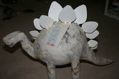There are lots of ways to make a stegosaurus piñata. If you do an Internet sear… There are lots of ways to make a stegosaurus piñata. If you do an Internet search you'll see many different stegosaurus piñatas. This is how Kerry and I made ours. Dinosaur Projects, Dinosaur Crafts, Dinosaur Art, Paper Mache Pinata, Paper Mache Diy, Dinasour Party, Art For Kids, Crafts For Kids, Dinosaur Birthday Party
