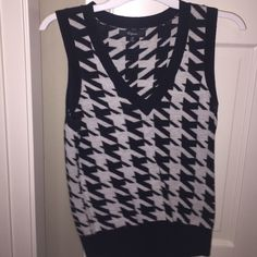 Size Small Houndstooth Express Sweater So, this sweater is meant to be worn over another shirt or with a jacket on top!  Definitely a layering piece!  I wore this item once, and it is in excellent condition. Express Tops