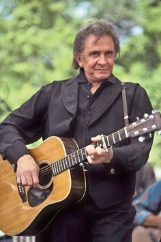 Johnny Cash, the man in black, his era of music makes me smile parts, June, Waylon and hank Sr.