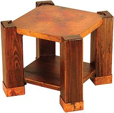 The Phoenix end table combines modern lines with rustic appeal and features a beautiful hand-hammered copper top cradled by wooden legs.  The distressed wood and fired copper are a natural match for each other. The end table includes a spacious bottom shelf that is perfect for magazines or books.   LaFuente.com