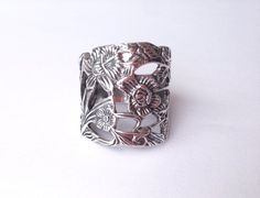 A personal favorite from my Etsy shop https://www.etsy.com/listing/495822715/flower-garden-ring-sterling-silver-925
