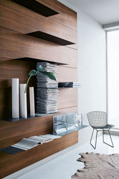 Dean selected a dark timber background panel for the custom shelving in their living area. Italian company Porro has a...
