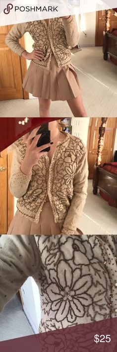 Embroidered cream sweater This sweater features pearls for the buttons and has a beautiful bronze embellishment that is seen throughout the whole front of the sweater. Size 36 which would fit a small-medium Imperial Fashion Sweaters