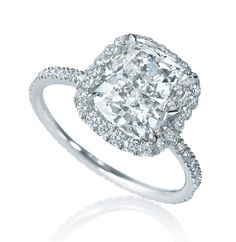 Harry Winston Micropave engagement ring in platinum, set with a 3.03ct cushion-cut diamond surrounded by 0.28ct of micropave diamonds