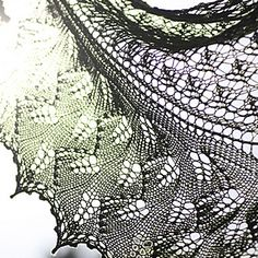 This lovely pattern begins with a cast-on along the entire edge of the center top triangle, and uses short rows to shape down to a point. The initial triangle is worked in lace with patterning on both sides. The stitches left from the short rows are then worked down and out from the initial triangle in a leaf motif, and they are bound off using a picot bind-off. The shawl may be enlarged easily.