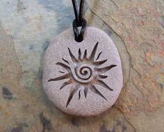 Items similar to Natural River Rock Necklace Engraved with Spiral Sun on Etsy - Dremel Projects Ideas Rock Necklace, Rock Jewelry, Clay Jewelry, Jewelry Crafts, Stone Jewelry, Jewellery, Stone Crafts, Rock Crafts, Arts And Crafts