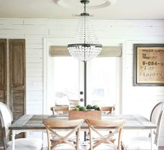 French country dining room. Shiplap walls. Pottery Barn chandelier. Room designed by Katie Nisbett