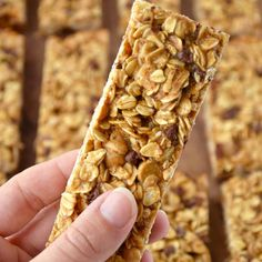 Holding a Homemade Peanut Butter Granola Bar with more granola bars in the background