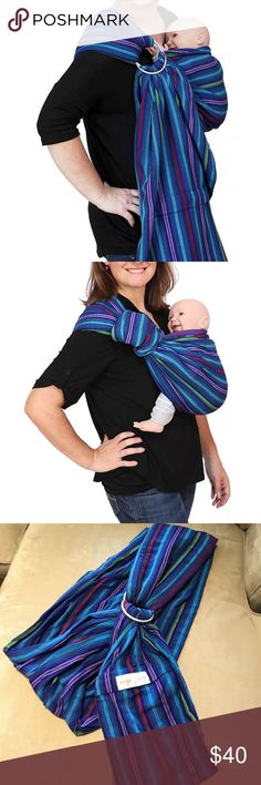 Maya Wrap ring sling. Maya Wrap ring sling in color 'berries' size small. You can wear newborns through toddlers. Recommended 8-35 lbs. Several different carrying positions. Built in zippered pocket. Padded shoulder for comfort. Only used a couple times. In perfect condition. Maya Accessories