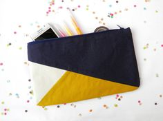 """Clutch 6""""X10"""" color block in navy blue and mustard"""