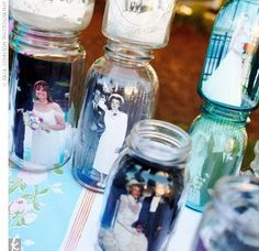 Place photos inside a mason jar and line them in the center of a table, on the fireplace or outdoor so create a photo art piece