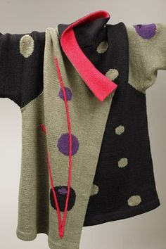 Sandra Miller. So gorgeous. Sleeve and front of 2 different sweaters with applique spots from 1st 2 and a 3rd