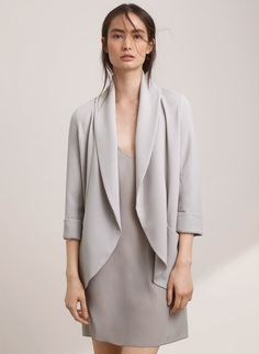 Love the feminine edge of this jacket. Looking for a long, drapey blazer that I could wear at work or out and about. Would do black or gray.