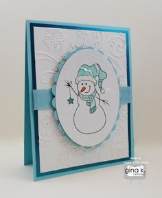 The Gina K Designs products used in this card are:  - Winter Cheer stamp set by Gina K Designs that is included in the Winter Cheer StampTV Kit - Pure Luxury card stock in 120 lb White and Ocean Mist - Color Companions Grosgrain ribbon in Ocean Mist - Pure Luxury Color Companions Ink in Black Onyx