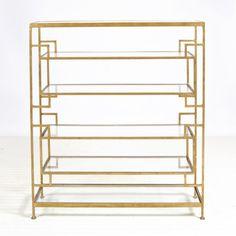 "Doris Gold Leafed Etagere. 47""h x 40""w x 12""d 6 shelf umber finished gold leaf etagere with glass shelves Top and bottom shelves are 7""h, inset shelves are 9""h,"