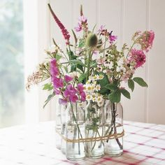 Insta-vase: Place six vintage milk bottles in three rows of three, and tie together with gardener's twine.
